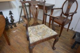 A George III oak provincial open armchair, in the Chippendale style, with pierced vasiform splat