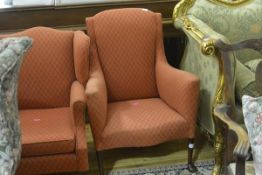 A small Edwardian library chair, in Georgian style, with serpentine seat, raised on tapering legs