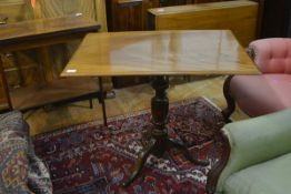 A George III tilt-top tripod table, the moulded rectangular top on a baluster standard and hipped