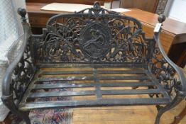 A cast-metal two-seater garden bench in 19th century style, the back centred by a cast panel with