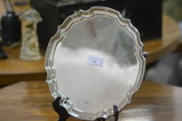 A silver salver in the Georgian taste, Sheffield 1972, with stepped scalloped rim, raised on leaf