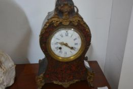 A 19th century gilt-metal and boullework mantel clock, the balloon case with a boullework panel,