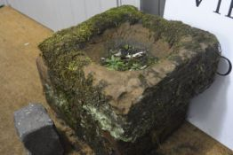 A rectangular weathered red sandstone trough. 22cm by 45cm by 31cm