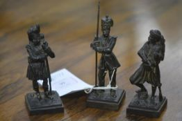 A group of three mid-19th century patinated bronze Crimean War figures comprising a Highlander,