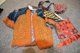 A Middle Eastern short jacket in blue velvet with orange silk embroidery and floral lining, possibly