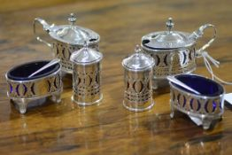 A matched set of George III style silver condiments, Victorian and later, various dates and makers