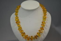 A Continental silver and amber (untested) necklace, composed of graduated chips with bead spacers (