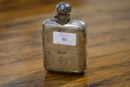 An Edwardian silver hip flask, G. & J.W. Hawksley, Sheffield 1907, shaped for the hand, with