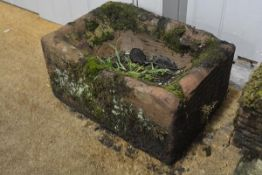 A square weathered sandstone trough. 14cm by 34cm square.