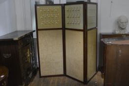 An early 20th century mahogany framed three-fold room screen, each leaf in two panels, the top