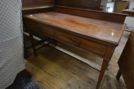 An Edwardian inlaid mahogany serving table, in 18th century style, with ledge back over a