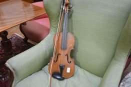 A violin, possibly 19th century, with two piece back, together with bow. Back 37cm