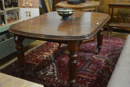 A Victorian mahogany wind-out dining table, the rectangular moulded top with rounded corners, raised