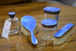 A George V silver and enamel matched partial dressing table set, Birmingham 1928 and 1929,