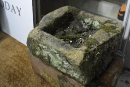 A square weathered red sandstone trough. 16cm by 39cm square