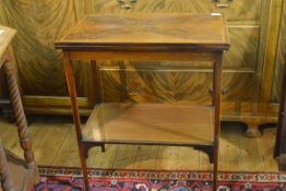 An Edwardian crossbanded and inlaid mahogany foldover card table, the rectangular quarter-veneered