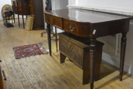 A Regency mahogany breakfront side table, with central tablet drawer flanked by two frieze drawers