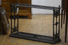A 19th century cast iron stick stand, probably Coalbrookdale, of eighteen divisions, with four urn-