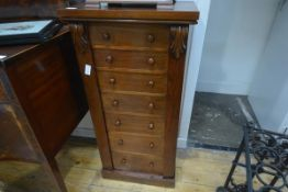 A Victorian mahogany Wellington chest, of characteristic form, the seven graduated drawers with