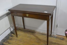A George III mahogany foldover tea table, early 19th century, the rectangular moulded top above a