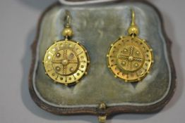 A pair of 19th century yellow metal drop earrings, in the Etruscan taste, each of circular form,