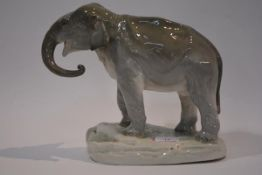 A large Czech porcelain model of a standing elephant, Amphora, impressed and painted marks. Length