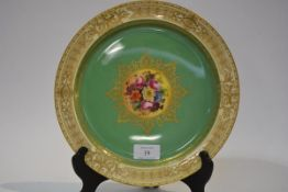 A Royal Worcester porcelain cabinet plate, painted by Ernest Barker, decorated to the centre with
