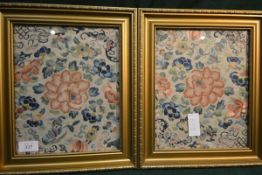A pair of Chinese silk needlework panels, c. 1900, each worked with flowers and butterflies