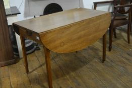 A George III mahogany Pembroke table, of characteristic form, fitted to each end with a frieze