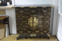 A Korean brass-mounted hardwood side cabinet, the rectangular top above three frieze drawers over
