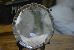 A silver salver in the George III taste, London 1971, with scalloped reeded rim and raised on