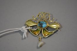 An Art Nouveau yellow metal brooch, centred by an oval turquoise cabochon and suspending a small