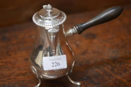 An Edwardian silver chocolate pot, London 1907, in 18th century style, pear shape, raised on pad