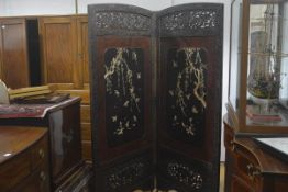 A Japanese two-fold lacquer and bone-mounted screen, each panel with fret-carved crest and frame