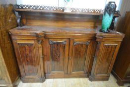 An unusual George IV shallow rosewood sideboard, the shelved superstructure with pierced fret-carved