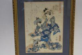 An 18th century Japanese woodcut, depicting elaborately dressed ladies, in the style of Utamaro or