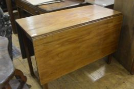A George III mahogany dropleaf dining table, the plain rectangular top with twin leaves raised on