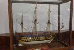 A large painted wooden model of an early 18th century three-masted man o' war, fully rigged, bearing