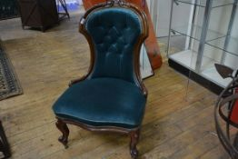 A Victorian mahogany framed button back nursing chair, in teal velvet, on cabriole legs moving on
