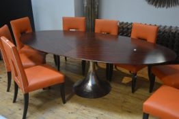 Julian Chichester, a large rosewood veneered Dakota dining table, oval, on a hammered nickel tulip