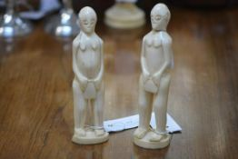 Two early 20th century naively carved ivory tribal figures. Taller 18.5cm