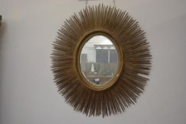 A large contemporary giltwood sunburst mirror. 150cm by 130cm