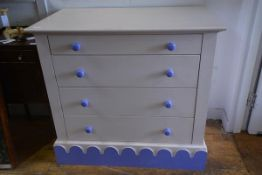 A Victorian style painted chest of drawers, with four graduated drawers over a scallop decorated
