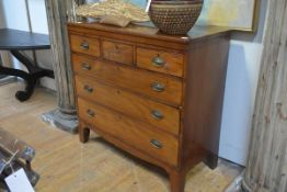 A George III mahogany chest of drawers, with three short over three long graduated drawers, on