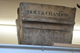 A very large wooden planter, printed Moet & Chandon. 54cm by 70cm by 60cm