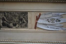 "A Boer War card, ""Christmas Greetings...from The Front, 1901"", the other leaf with a photograph"
