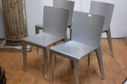 A set of four Italian chairs by Molteni & Co., of composite materials, in a silvered finish.