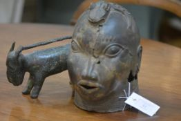 A Benin bronze head,with staring eyes and zoomorphic headdress; together with a bronze model of a