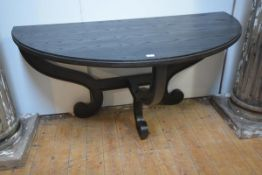Julian Chichester, a large demilune side or serving table, in a dark stained oak finish, with boldly