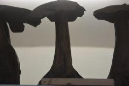 A carved wooden mushroom garden ornament. Height c. 55cm